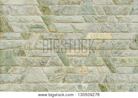 pattern color of modern style design decorative green slate stone wall surface with cement in trapezoid shape