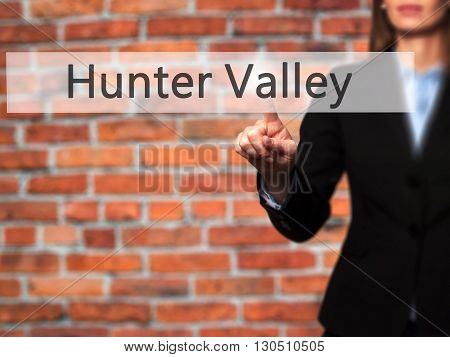 Hunter Valley - Businesswoman Hand Pressing Button On Touch Screen Interface.