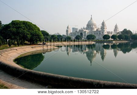 Park near the beautiful Victoria Memorial Hall of Kolkata at the sunny day. The Memorial is the largest repository in India for a visual history of Calcutta.