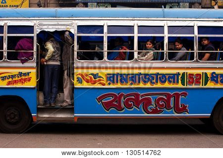 KOLKATA, INDIA - JANUARY 15, 2013:People on the move come in the colorful bus on January 15, 2013 in Kolkata India. Kolkata and its suburbs is home to approximately 14.1 million people.