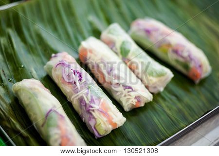 Fresh made spring rolls Poh Pia Sod. Traditional thai cuisine served on banana leaf