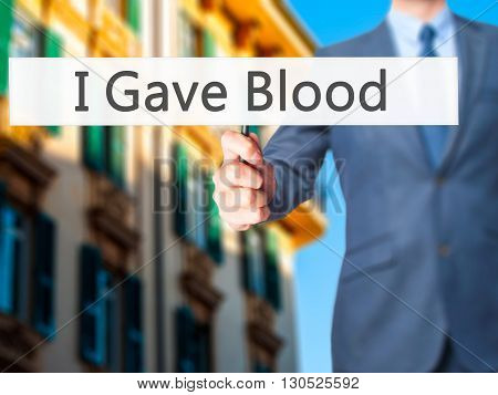 I Gave Blood - Businessman Hand Holding Sign