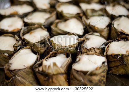 Fresh made thai Khanom tako made with coconut milk. Traditional thai dessert served in banana leaf.