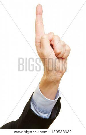 Businessman holding index finger up as a warning sign