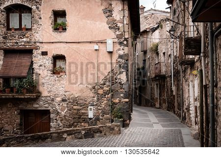 Deserted ancient street in medieval village Castellfollit de la Roca