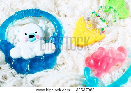 Set of teethers for newborn baby, selective focus