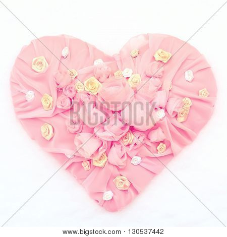 Pink Textile chiffon Heart with roses and other flowers on a snow background