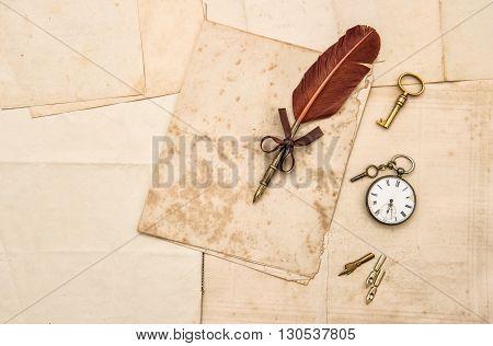 Vintage papers and ink pen. Nostalgic sentimental background for scrapbooking