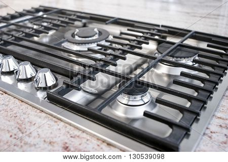 modern gas kitchen with traditional cooktop panel
