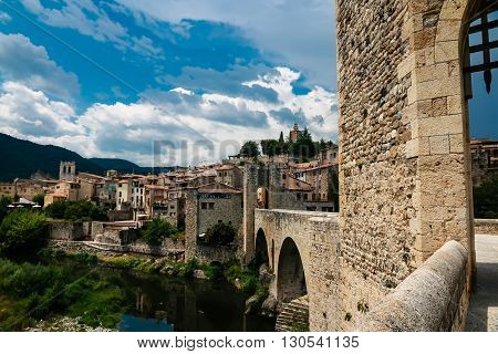 Medieval gothic stone bridge with view at ancient village