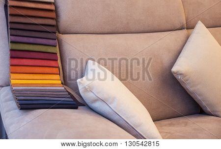 View of colored leather on gray sofa