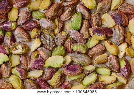 Green pistachio nuts without shell in a wooden box