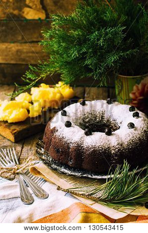 Delicious vegan chocolate cake. Chocolate cake with marzipan and bluepberries. Chocolate cupcake. Delicious chocolate cupcakes with spring flowers. Rustic style.