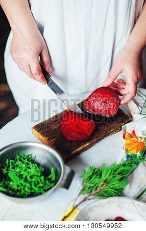 Vegetarians and cooking. Ladies hand cut green vegetable ready to prepare healthy salad. Country style. Dieting concept. Woman cooking. Housewife who enjoys cooking