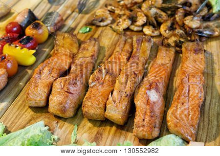 Grilled red fish on a street festival