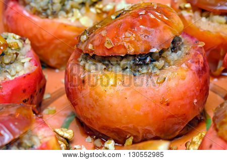 Delicious baked apples filled with buckwheat porridge, nuts, plums, honey and apricots.