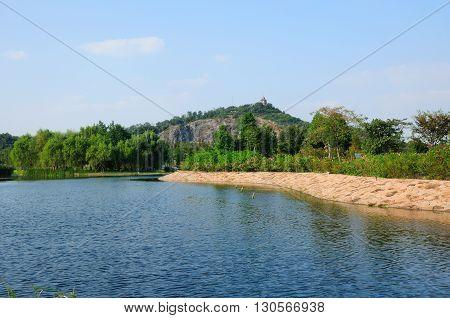 A manmade lake and rose garden within Chenshan Botanical Garden in Songjiang district Shanghai China.