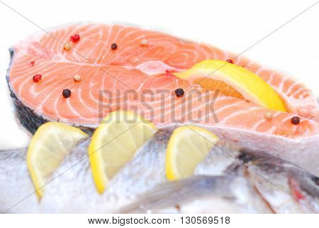 fresh beautiful salmon fish in fridge over white