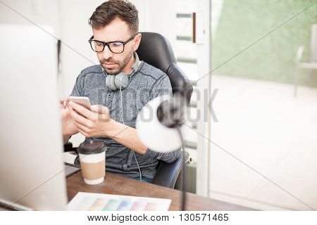 Taking A Break From Work And Using Smartphone