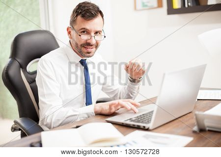 Hispanic Accountant Working With Glasses On