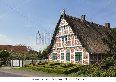 Typical thatch-roof half-timbered farmhouse at Altes Land region, Lower Saxony, Germany