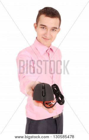 Young man holds in his hand black computer optical mouse isolated on white background soft focus