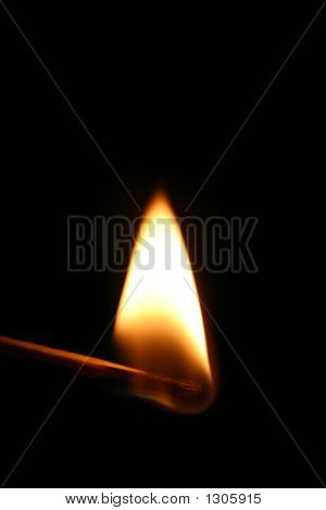 A red hot burning flaming match stick.
