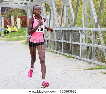 PILSEN, CZECH REPUBLIC - APRIL 23, 2016: Hellen Jepkosgei Kimutai from Benedek Team Debrecen on Plzensky pulmaraton (half marathon) run. Most popular international sport event in Western Bohemia.