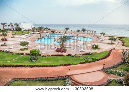 MARSA ALAM , EGYPT, MARCH 27, 2016: Three Corners Equinox Beach Hotel at Red Sea shore - swimming pools