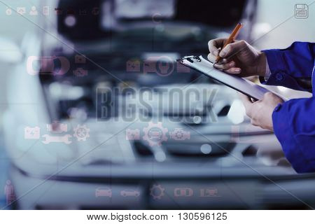 Engineering interface against close up of a man writing on a clipboard