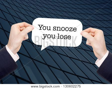 You snooze you lose written in a speechbubble