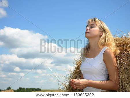 Portrait of smiling beautiful girl enjoying sun outside