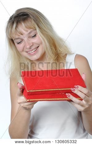 Beautiful woman astonished with the surprise inside of the red box