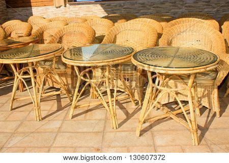 Wooden Tables and Chairs in a City Cafe. The Cafe is Unoccupied.