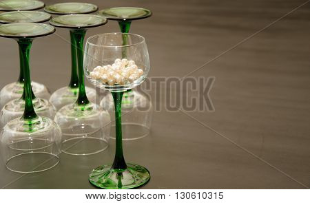 Classic Green Stemmed Wine Glasses Overturned in a Triangular Fashion