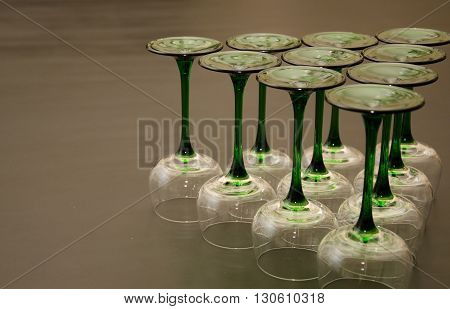 Ten Classic Green Stemmed Wine Glasses Overturned in a Triangular Fashion