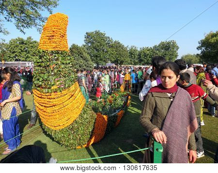 Chandigarh-Feb 20: Visitors admiring flower art and posing for picture at Zakir Hussain Rose Garden during Rose Festival, Sector 16,  Feb 20, 2016 in Chandigarh, India, Asia.