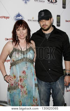 Annie Duke and Joseph D. Reitman at the 2nd Annual Celebrity Poker Tournament to Benefit The Urban Health Institute held at the Playboy Mansion in Holmby Hills, USA on April 28, 2007.