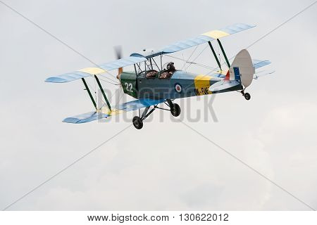 Pribram CZE - MAY 20 2016: DH 82c TIGER MONTH - replica biplane flying in Pribram