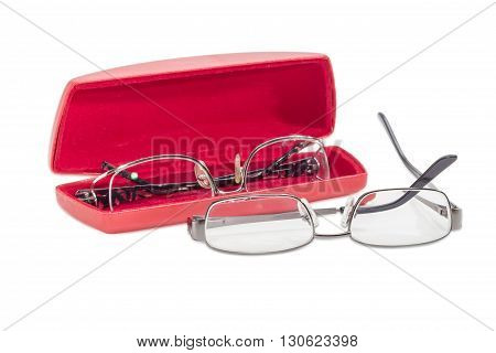 One modern pair of women's eyeglasses in open red spectacle case and one pair of eyeglasses with metal frame beside on a light background