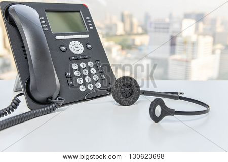 IP Phone and headset device on the white table