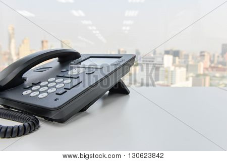 Black IP Phone for business communication on the white table