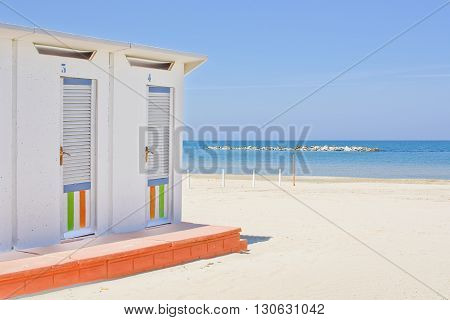 Cabins on the Adriatic beach and sea in the background poster
