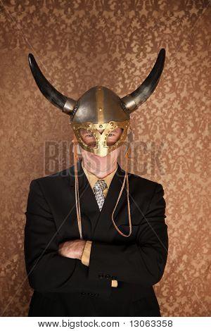 Businessman in dark suit and viking helmet poster
