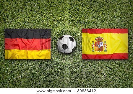Germany Vs. Spain Flags On Soccer Field