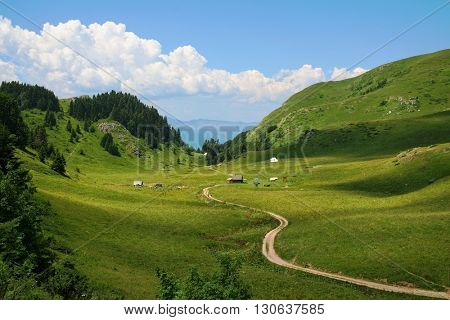 sinuous trail crosses a mountain valley in