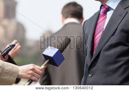 Media interview. Journalists interviewing spokesman, businessman or politician.