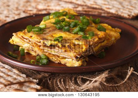 Matzo Fried With Eggs And Green Onions - Matzah Brei Close-up. Horizontal