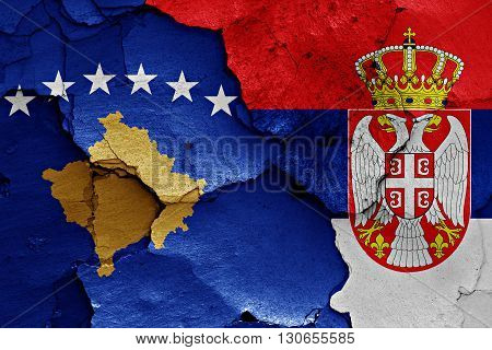 flags of Kosovo and Serbia painted on cracked wall poster