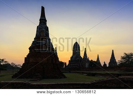 the ancient Buddha temple at Ayuthya historical park with the twilight time silhouette pagoda
